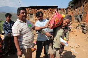 Giving man bag of rice